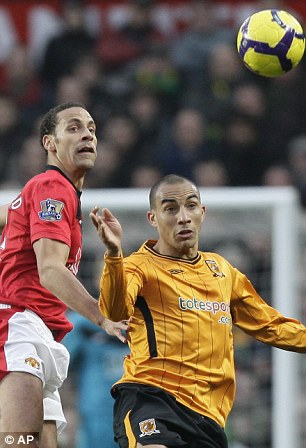 Rio Ferdinand (left) came together with Hull's Craig Fagan