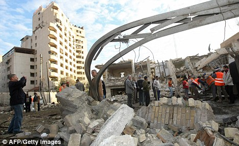 Iraqis inspect damages a day after a bomb blast
