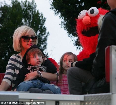 Lucky tot: Christina Aguilera celebrates son Max's second birthday with Elmo on the top of a fire engine