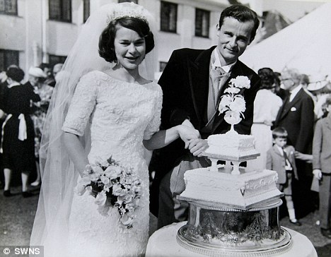 Cutting the cake: Robert and Jane on their wedding day in 1962