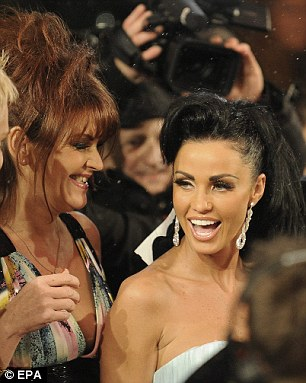 Katie Price (L) with her host Alexander Mayer before the start of the Vienna State Opera Ball