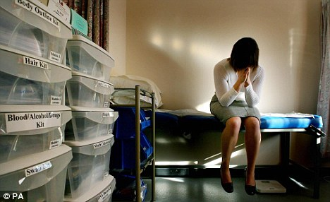 An alleged rape victim waits to be seen by the doctor in the medical room at a specialist rape clinic in Kent