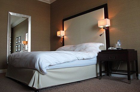 Deadly: Bedside lamps in a hotel room similar to the one used by the assassinated Hamas commander