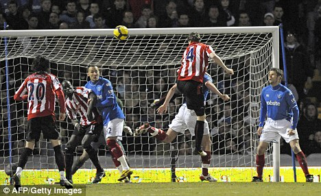 Stoke City's German defender Robert Huth (second right) scores against Portsmouth
