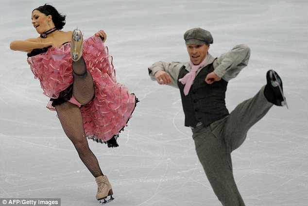 Ooh la la: French skaters Isabelle Delobel and Olivier Schoenfelder performed a Can Can-style dance that would not have looked out of place in the Moulin Rouge