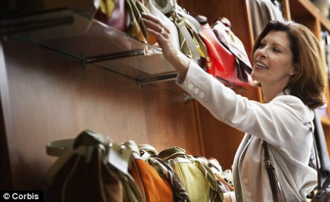 Bagging a deal: Around two-thirds of women surveyed said they would like to buy even more handbags, if they could get away with it