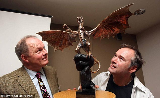 Believers: Mr Wingett with artist Steve Winterburn, who has constructed a scale model of the sculpture