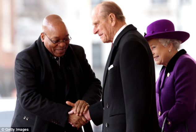 All smiles: Mr Zuma greets Prince Philip and the Queen today