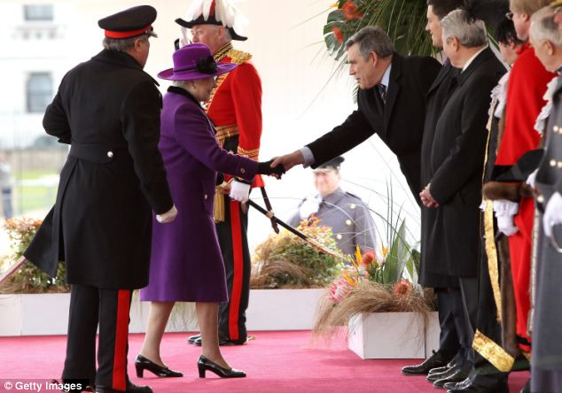 The Queen greets Gordon Brown during the ceremonial welcome for Mr Zuma