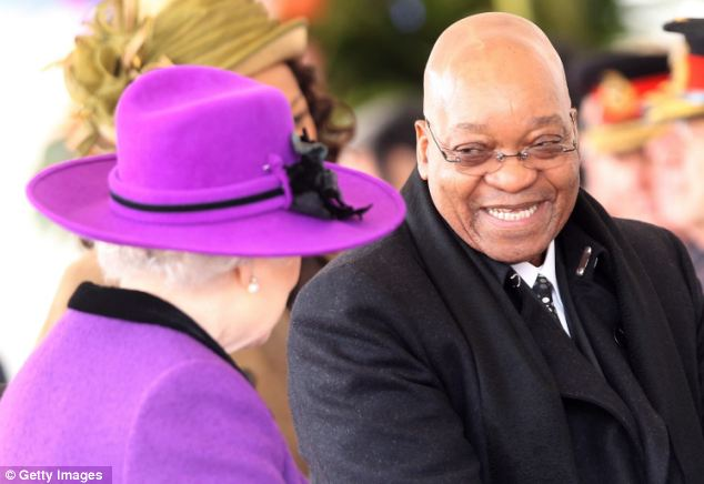All smiles: The South African President greets the Queen