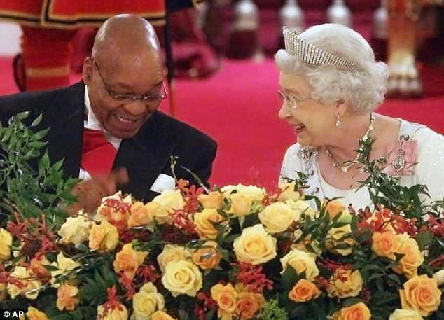 We are amused: The Queen and Mr Zuma share a joke at the start of the State Banquet