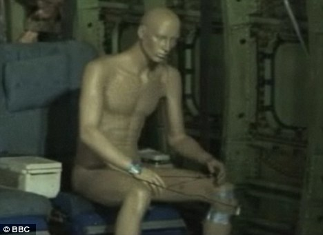 The mannequin, carrying the same explosives found, before the test