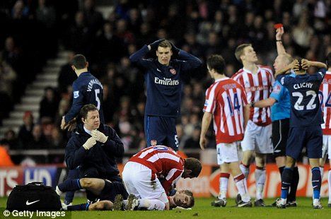 Ryan Shawcross is sent off for a challenge on Aaron Ramsey