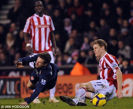 Ryan Shawcross tackles Aaron Ramsey