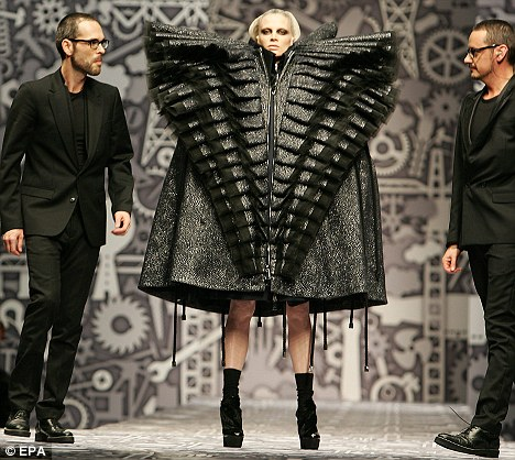 One for Lindsay? Dutch fashion designers Viktor Horsting, right and Rolf Snoeren show one of their more outlandish designs