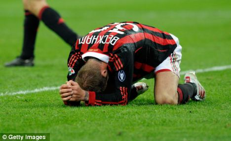 David Beckham lies injured