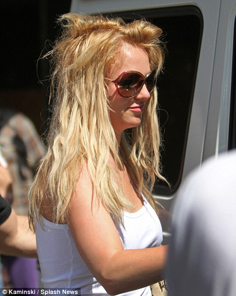 Unkempt: The 28-year-old mother of two let her bedraggled hair out as she left the Sunset Plaza