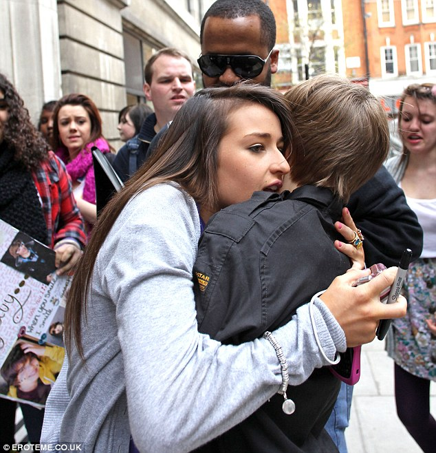I got him: One lucky girl made it past the bodyguards to hug Bieber
