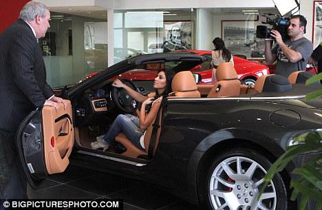Kim Kardashian and Kourtney Kardashian with her son Mason Disick are seen car shopping in Miami, Florida