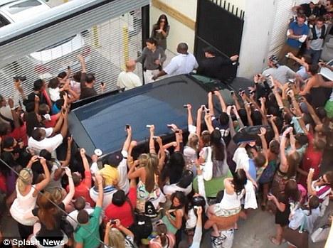 Little miss popular: Fans swarm Kim Kardashian as she leaves her Dash store in Miami