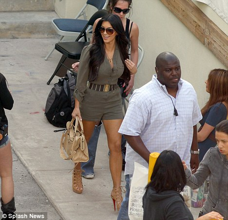 Making a Dash home: Kim looked over the moon to be greeted by such a large crowd as she left her shop in Miami