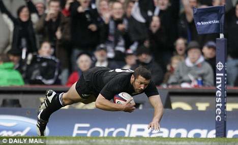 End game: New Zealander Aaron Mauger scores a try at Twickenham against England - but he has now been forced to retire