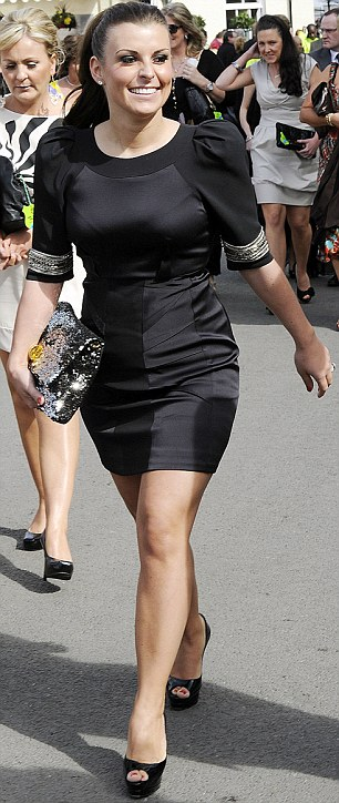Elegant: Coleen Rooney arrived at Aintree yesterday in a chic black mini dress and Christian Louboutin heels
