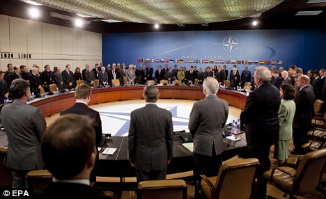 A minute's silence is observed during the NATO meeting for the 96 killed in the plane crash