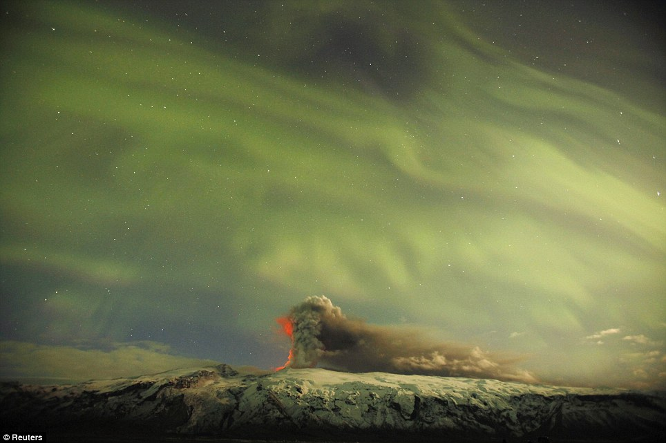 The Northern Lights are seen above the ash plume of Iceland's Eyjafjallajokull volcano last night