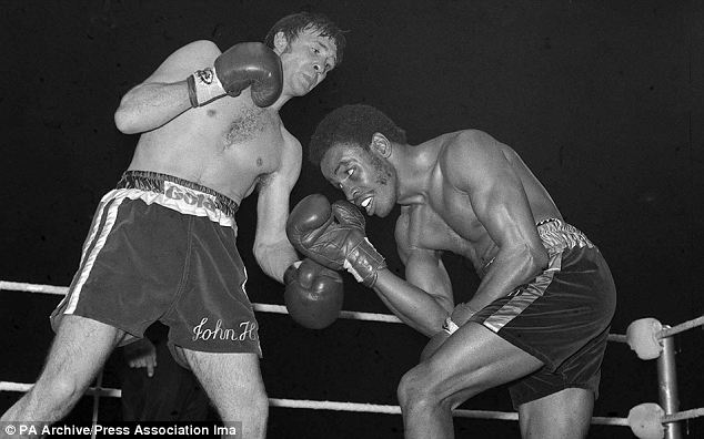 World welterweight champion John H Stracey seeks an opening as his skilled American challenger Hedgemon Lewis