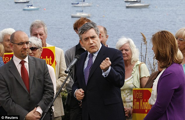 Gordon Brown accompanied by his wife Sarah (right) greets supporters in Weymouth, southern England