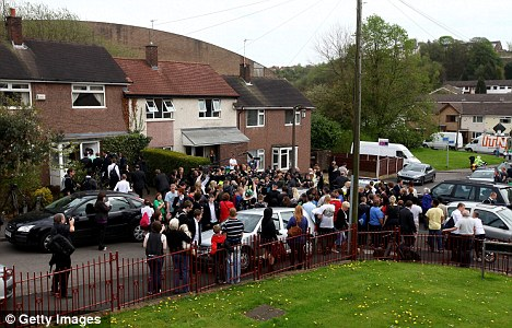 Members of the press await Gordon Brown's exit from pensioner Gillian Duffy's home