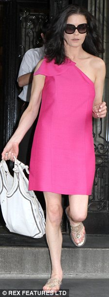 Not so fabulous in fuchsia: Catherine Zeta-Jones looks washed out and skinny as she leaves her Manhattan apartment yesterday