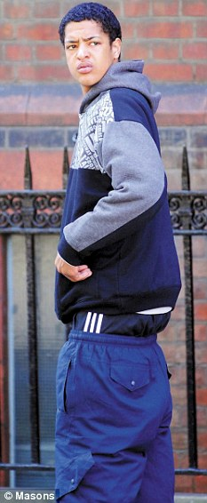 Ellis Drummond leaving Bedford magistrates' court. He had been facing a ban on wearing low-slung trousers and hooded tops