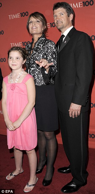 Night out: Actress Leslie Mann and husband Judd Apatow and, right, Sarah Palin and her daughter Piper and husband Todd