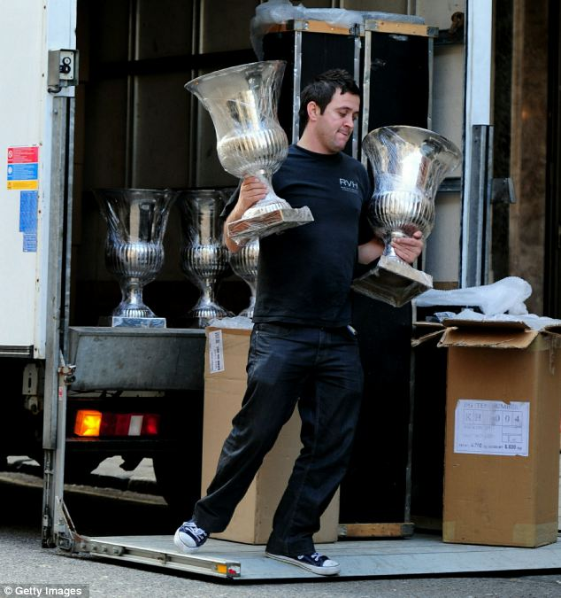 No expense spared: What appeared to be giant silver goblets are carried into Claridges