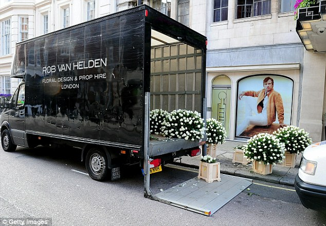 Blooming: Floral arrangements for the Walliams/Stone wedding arrive - Ronnie Corbett was amazed by the sheer amount of white roses