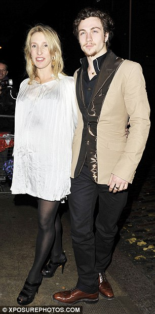 Rock and roll guests: Former Oasis star Noel Gallagher and his girlfriend Sara MacDonald and a pregnant Sam Taylor-Wood and her fiance Aaron Johnson