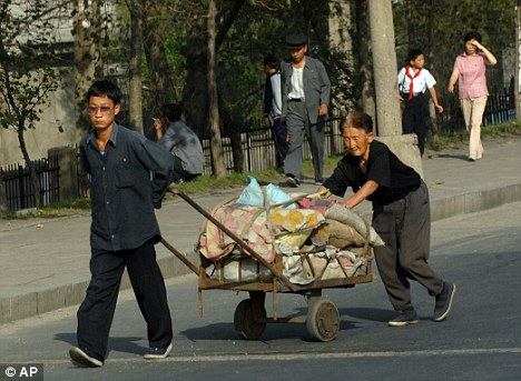 Grinding poverty: North Koreans are five inches shorter than their southern cousins