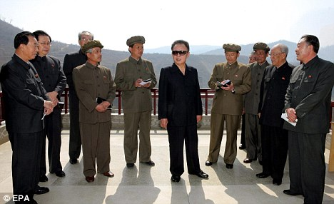 Henchmen: Kim surrounds himself with obliging y- but ageing - yes men