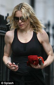Madonna with bulging biceps