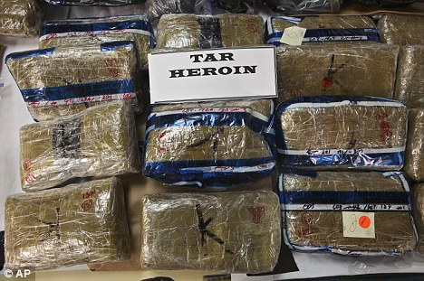 Demand: Mexican tar heroin seized by police. Dealers are selling bags for as little as £7