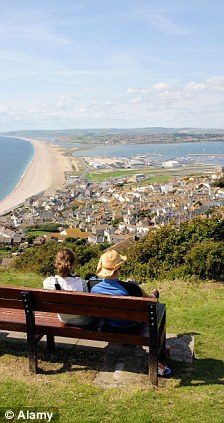 Couple sitting on a seat on the Isle of Portland