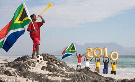 Boys posing on Cape Town beach for World Cup
