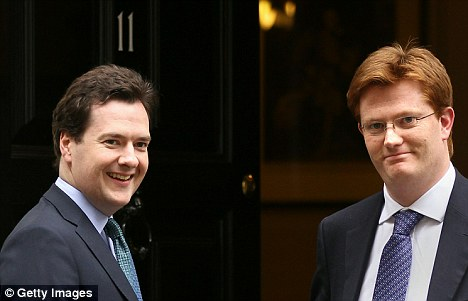 Newly appointed Chief Secretary to the Treasury Danny Alexander (R) stands with Chancellor of the Exchequer George Osborne