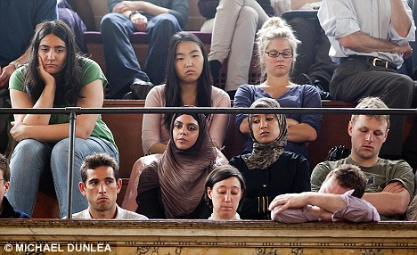 Bored: Not everyone in the audience was as interested as Prince Charles though