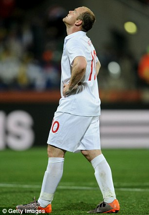 Dejected: Wayne Rooney shows his frustration against the USA