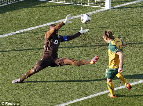 Fine start: Brett Holman punishes Ghana keeper Richard Kingson for his blunder