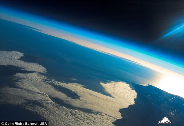 One of the incredible photographs capturing the suns glinting behind the earth taken at 125,000 feet over the Californian Pacific coast