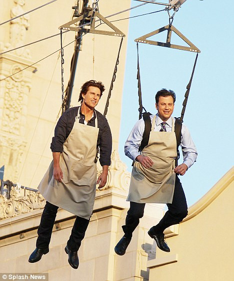Flying without wings: Tom Cruise and Jimmy Kimmel ziplined across Hollywood Boulevard yesterday